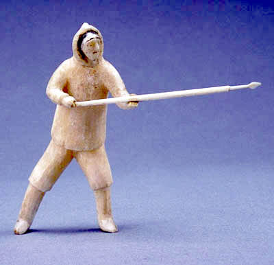 Sculpture of a standing hunter with a harpoon