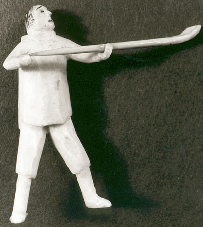Sculpture of a standing man holding an ice-scoop