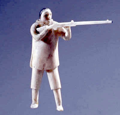 Sculpture of a hunter wielding a gun.