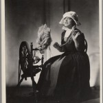 Juliette Gaultier de la Vérendrye at the spinning wheel in costume