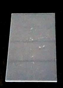 A dusty glass microscope slide.