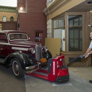Collections specialists moving the Dodge Fargo pickup truck out of the Canada Hall using the modified route.