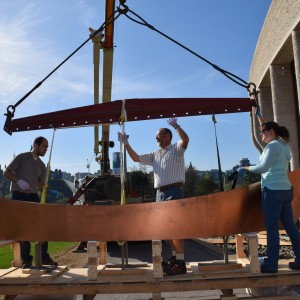 Preparing to reinstall the canoe portion of the sculpture.