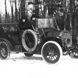 Women driving a Ford T in the snow