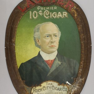 Tin advertising sign for The Rock City Cigar Co. The front of the sign shows Laurier on a green background. Canadian Museum of History, 1999.124.16