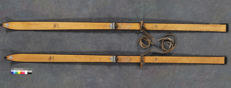 Pair of wooden Piper cross-country skis from the 1940s. The skis were used by Denis Allard and family to deliver mail from the Fort Alexander Reservation to the Pine Falls Post Office, when a winter blizzard made the roads impassable. Canadian Museum of History, 2006.241.1 a-b, IMG2008-0568-0045-Dm