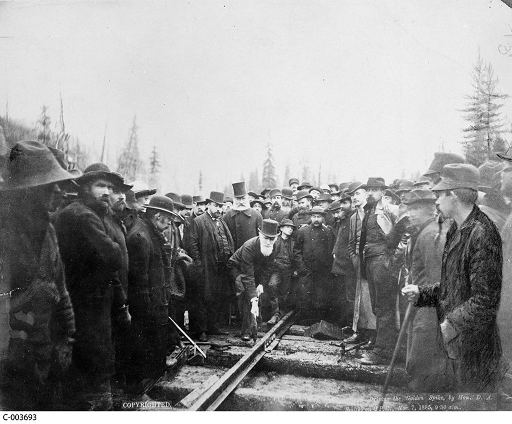 Euro-Canadians envisioned the region as the final piece in their transcontinental Dominion. Hon. Donald A. Smith driving the Last Spike to complete the Canadian Pacific Railway. Alexander Ross. Library and Archives Canada. C-003693