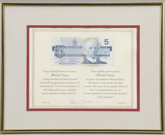 Framed five-dollar bill featuring Laurier, presented by Prime Minister Jean Chrétien to his advisor Mitchell Sharp to thank him for five years of volunteer service to the Cabinet, December 1999. Canadian Museum of History, 2005.32.67. Gift of Jeanne d'Arc Labrecque Sharp. IMG2008-0060-0085-Dm