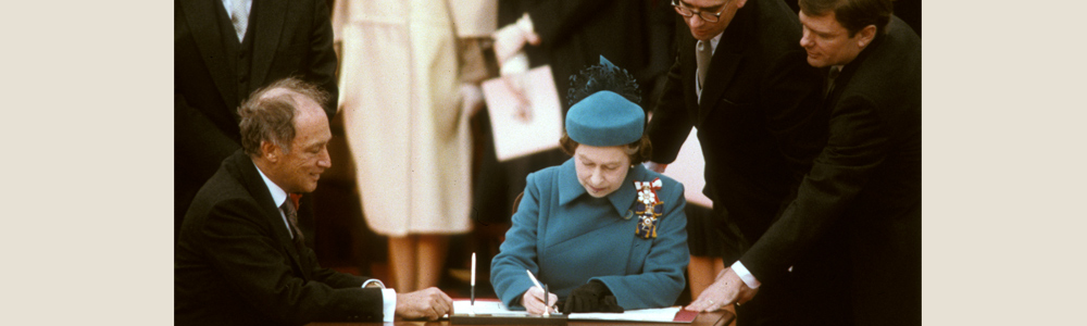 Her Majesty the Queen signing the Constitution