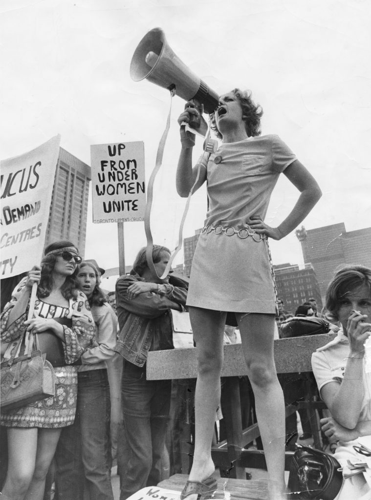 Feminist Jackie Henderson at a rally Reg Innell, Nathan Phillips Square, Toronto, August 26, 1970. Reg Innell and Toronto Star via Getty Images, 538953072.