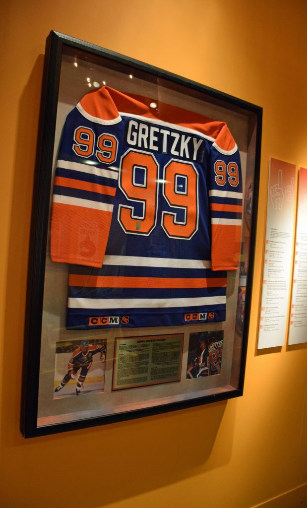 The commercial framing of this Wayne Gretzky jersey was altered to make use of more conservation friendly methods and materials, while retaining the original look. Photo: Canadian Museum of History.