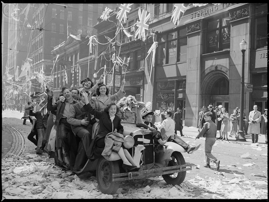 Toronto residents flood Bay Street to celebrate VE Day. John H. Boyd, Toronto, May 8, 1945. City of Toronto Archives , Fonds 1266, Item 96241