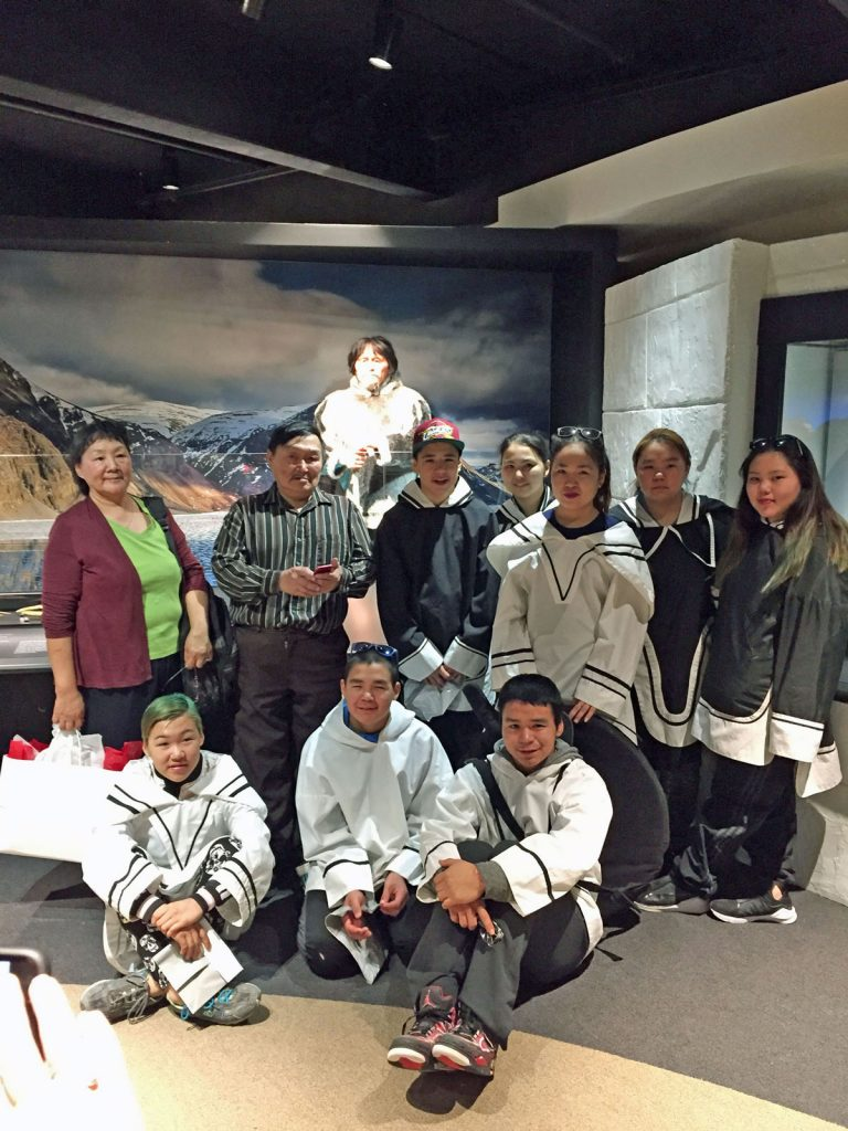 Members of the Arctic Bay community and the Inuit Heritage Trust attend a private unveiling ceremony in April 2017. Photo: Canadian Museum of History