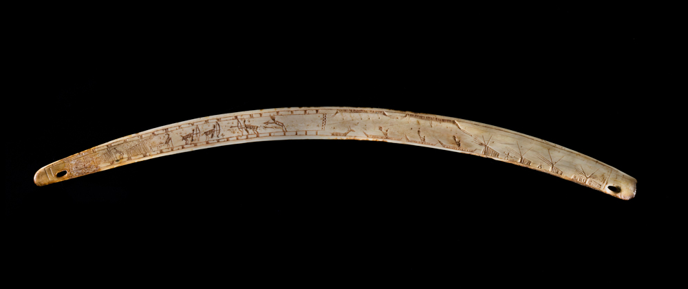Nuvumiutaq was buried with his hunting equipment, including a bow-drill incised with scenes that may illustrate events from his personal life. Muscle and trauma marks on his skeleton corroborate the picture of a skilled kayaker and hunter who lived an eventful life. Photo: Canadian Museum of History