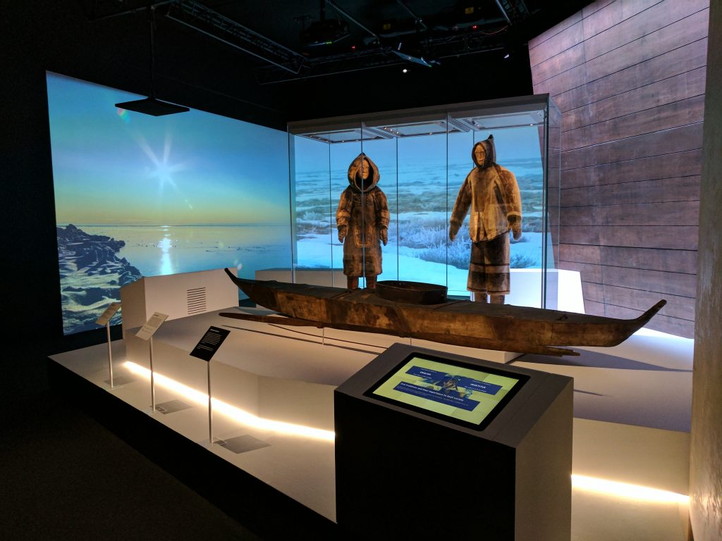 Inuit summer outfits and a kayak, all more than 100 years old, at the National Maritime Museum. The listening station (bottom right) features Louie Kamookak speaking about the ongoing importance of the Inuit oral history tradition. Photo: Canadian Museum of History