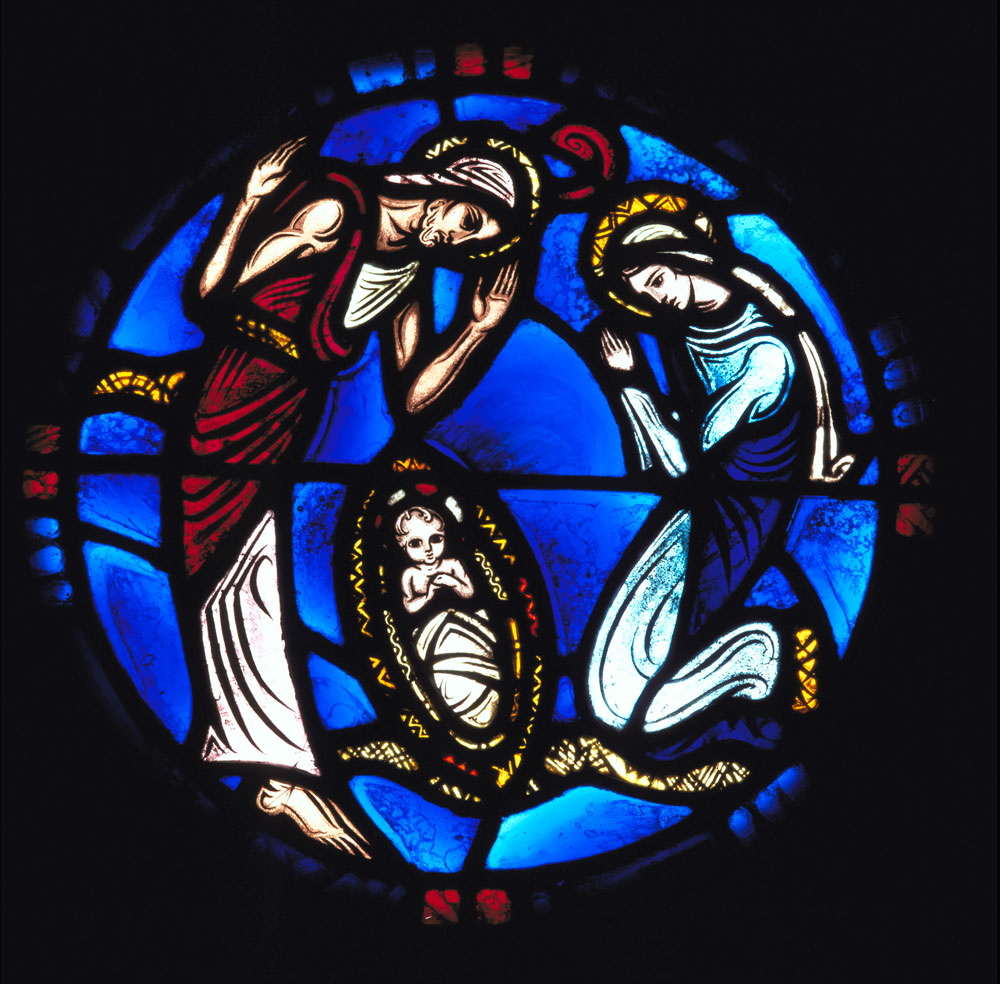 Stained-glass window featuring the Nativity