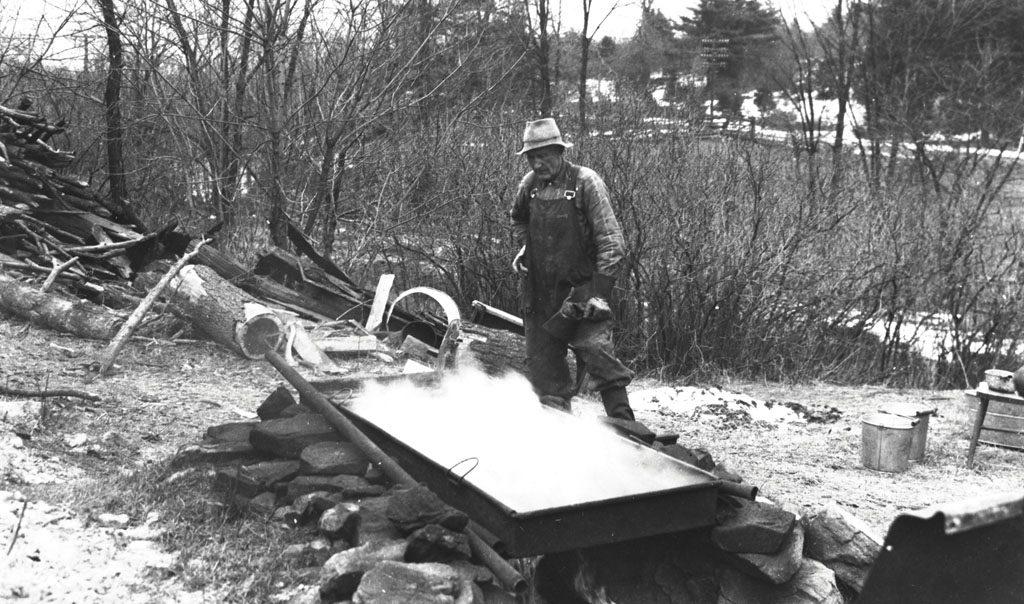 Man making maple sugar