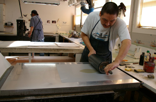 "Printmaker Niviaqsi Quvianaqtuliaq creating a lithograph proof for, ""Halibut,"" by Ningeokuluk Teevee"
