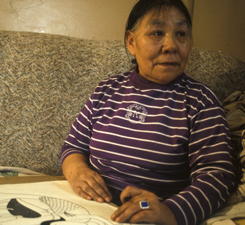 Kenojuak Ashevak using a black ink felt pen to draw what would become the print