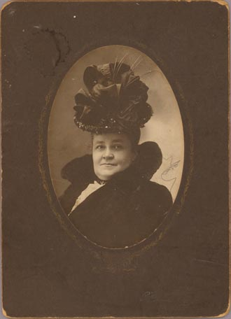 Photograph of a woman wearing an elaborate hat