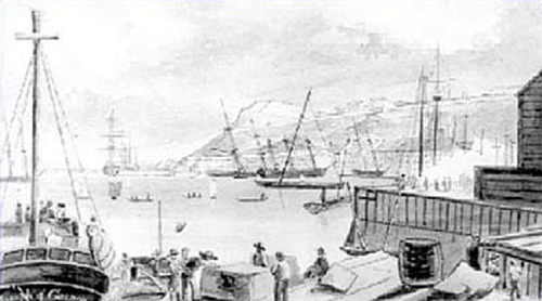 Picture of men unloading a ship in the harbour.