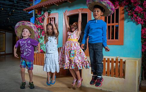 Children in costume jumping