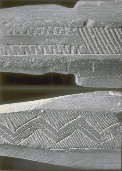 Decorations engraved on two stone bayonets.