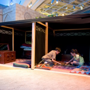 Children playing in a Bedouin tent