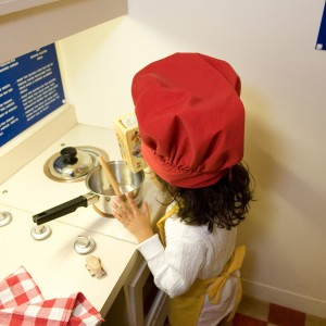 Child playing in the KIds' Café