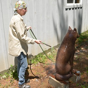 The process of creating the patina for the bronze wolf sculpture at the artist's studio