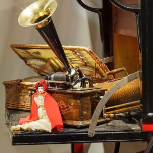 Doll, picnic basket and phonograph
