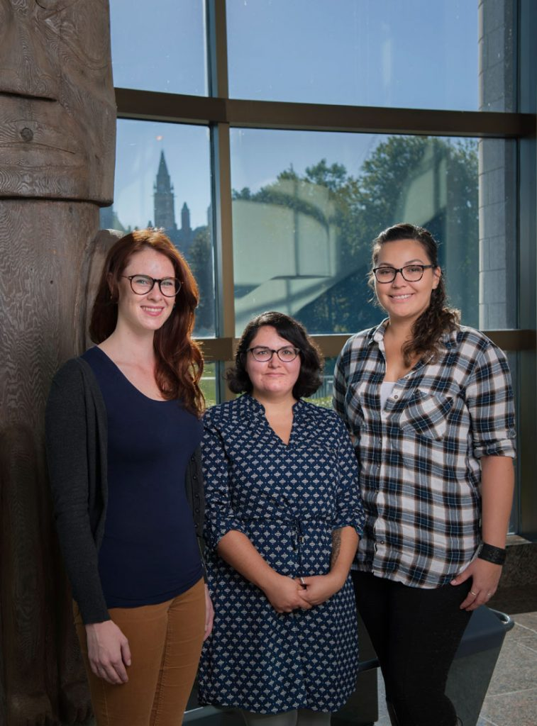 ATPMP interns Jessica Maclean, ​Meagan Barnhart and Kylie Rose Bressette posing in the Canadian Museum of History's Grand Hall .