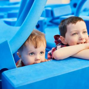 Children with big blue foam blocks
