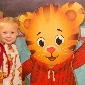 Young girl with Daniel Tiger