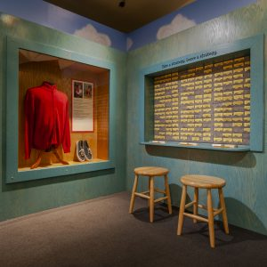 Mr. Rogers' jacket and shoes in the Daniel Tiger exhibition space