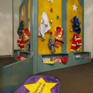 Costumes hang in the Daniel Tiger exhibition space