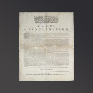 """Document featuring a coat of arms and the words """"By the King a Proclamation"""" and """"God save the King."""""""