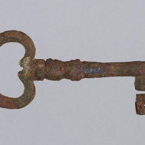Heavily rusted iron key