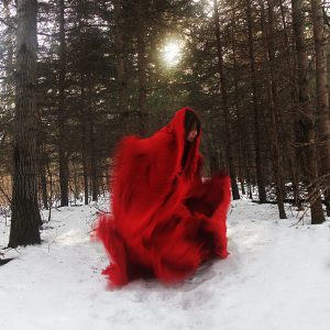 A woman dressed in red