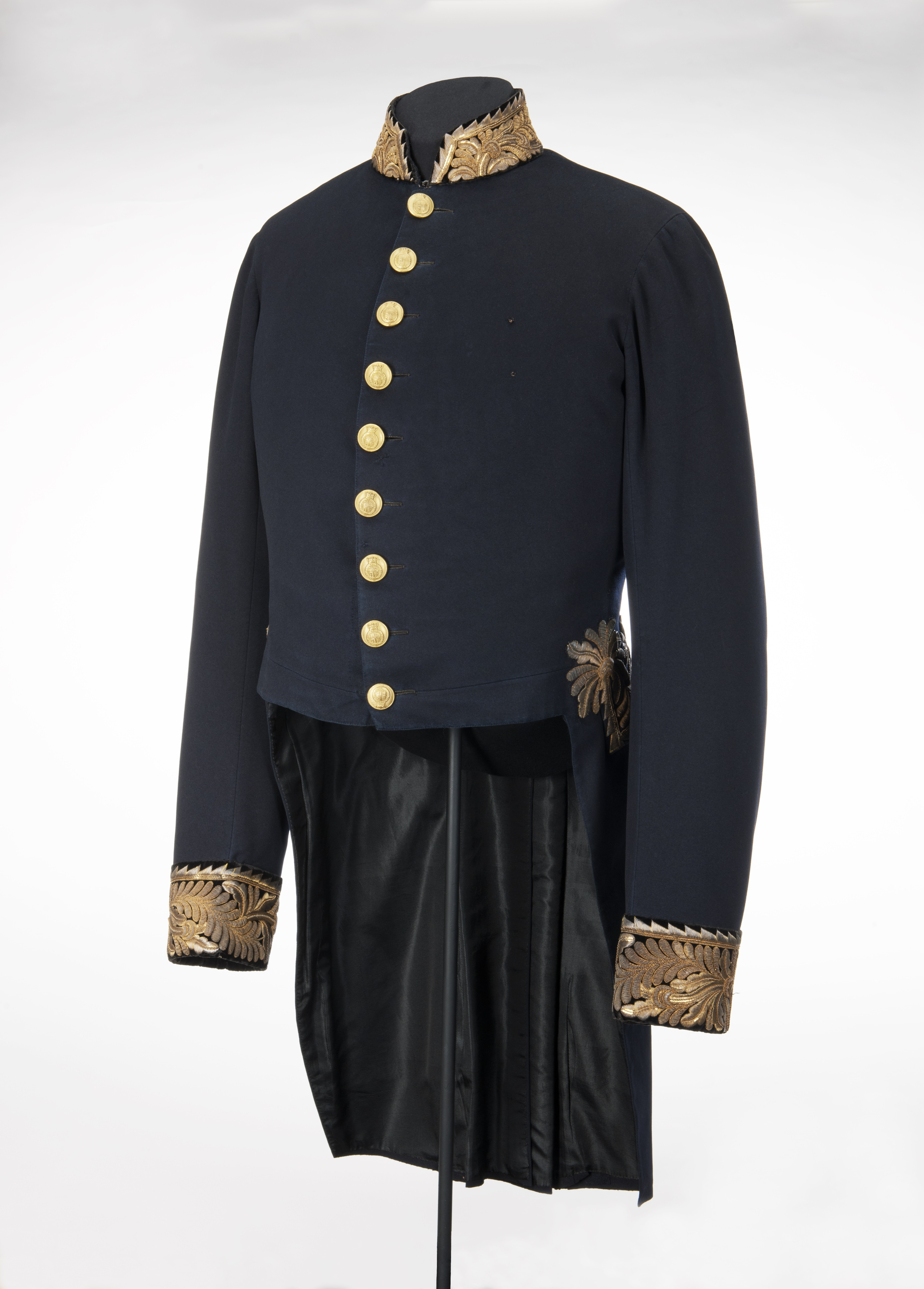 blue civil uniform jacket with gold cuffs and buttons.